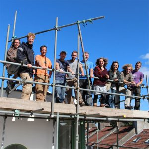 Self Build Project In Bristol, here we see the Bright Green Futures & Nature Design and Build standing together on top of some scafolding