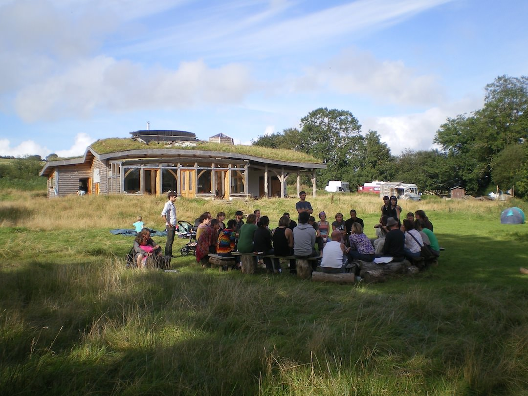 Communal Gathering In The Grass Outside A Small Holding Lammas Ecovillage Bright Green Futures